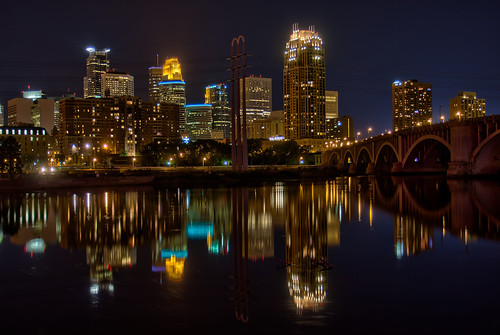 Photo of Minneapolis at night as reflected in the Mississippi